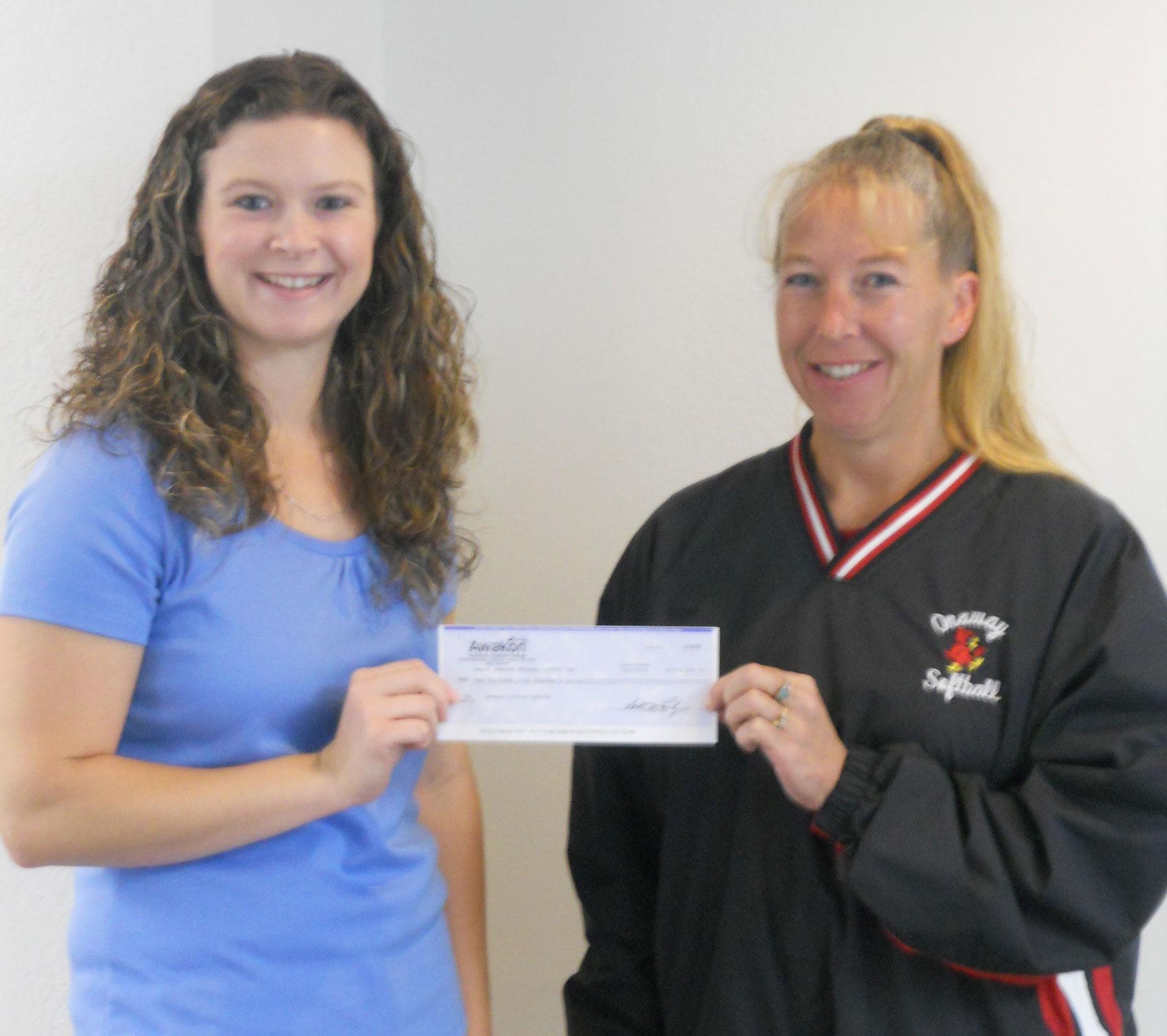 Organization receiving a donation check from Awakon